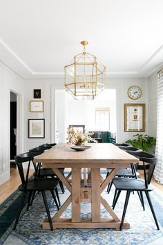 Modern dining room lighting with rustic farmhouse table and classic chairs