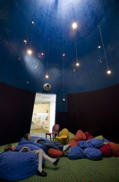 Hercules Public Library - The deep blue 'story cone' transports kids to a magical world with a 'butterfly shade' to modulate skylight