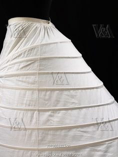 Covered cage crinoline. Cane and cotton. England, 1860s