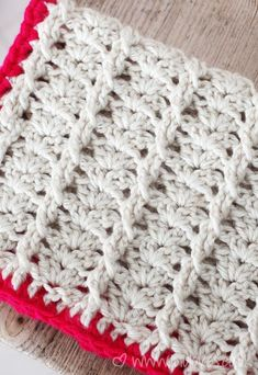 Cables and shells by Lulu Loves. Free Cabled & Shell Throw pattern by Red Heart here http://www.redheart.co.uk/free-patterns/cabled-shell-throw