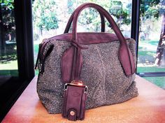OH THE PURPLE! I love this purse.