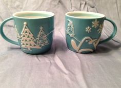 Holiday 2007 Starbucks Coffee Mugs x2 Penguins Snowflakes Trees Embossed 8 oz