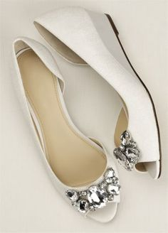 """This low peep toe wedge features a crystal cluster embellishment that will sparkle the whole night through! Heel height: 1 1/4"""". Available in White, Champagne Metallic and Silver Metallic. Imported. $55.60"""