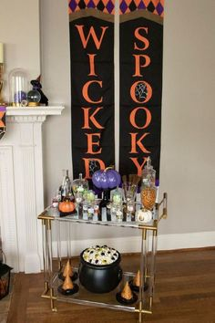 How to set up a Halloween bar cart as a DIY mobile potion station, inspired by the movie Hocus Pocus. Get these decor ideas and more for a Hocus Pocus Themed Halloween Craft Party at fernandmaple.com!
