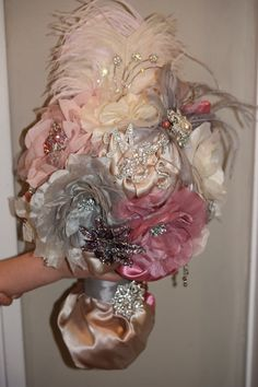 I just made my bouquet. Since I hate flowers I made it from satin fabric, crystal brooches, feathers and ribbon :) Blush, charcoal, champagne and ivory are my wedding colors http://media-cache4.pinterest.com/upload/71002131595338804_KKZzZXGL_f.jpg myoung421 wedding ideas