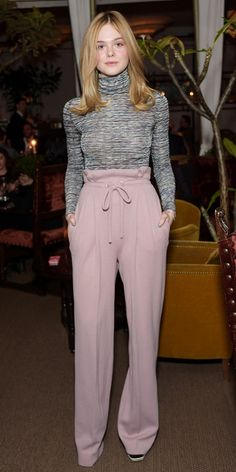 Elle Fanning turtleneck and pink trousers