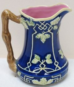 reproduction, I own one with the label still intact. Made in China for Charles Sadek Co. It is a well made pitcher but not Victorian Majolica.