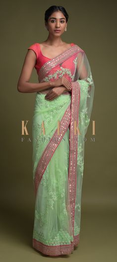 Buy Online from the link below. We ship worldwide (Free Shipping over US$100)  Click Anywhere to Tag  Pista Green Saree In Net With Applique, Thread And Sequins Embroidered Floral Pattern Online - Kalki Fashion  Pista green saree in net with applique, thread and sequins embroidered floral pattern.It comes with a pink border enhanced with zari and sequins work.