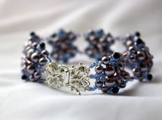 Hand Beaded Bracelet with Bright Sterling Silver by pjlacasse