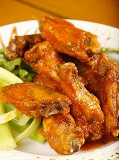 Periwinkle Place | Sanibel Island — Why not stop into Blue Giraffe for the best wings on #Sanibel? 8 crisp and juicy wings smothered in your choice of atomic, hot, medium or mild buffalo sauce and served with celery & carrot sticks and blue cheese or ranch dressing! Best Wings, Carrot Sticks, Sanibel Island, Ranch Dressing, Blue Cheese, Chicken Wings, Celery, Crisp, Carrots