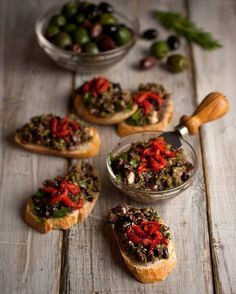 Olive Bruschetta. 1/2 C black olives (kalamata) 1/2 C green olives (Castelvetrano) 2 cloves garlic 2 T capers 2 T Italian parsley, chopped 1 T fresh rosemary, chopped 2 T lemon juice 2 T olive oil Salt and pepper to taste Combine all ingredients in a food processor and process just enough to chop finely, we don't want our tapenade to turn into mush.