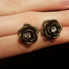 Pretty Rose Earrings Bronze and black colored rose shaped post earrings with sparkly stone in the middle. They were worn maybe twice. Quarter pictured for size reference. Claire's Jewelry Earrings