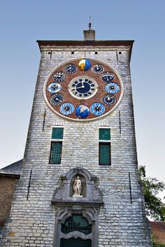Zimmer Tower in Lier, Flanders, Belgium was originally a keep of Lier's fourteenth century city fortifications. In 1930, astronomer and clockmaker Louis Zimmer (1888–1970) built the Jubilee (or Centenary) Clock, which is displayed on the front of the tower.