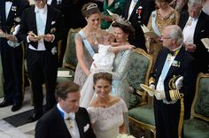 drc:  Wedding of Princess Madeleine and Chris O'Neill-June 8, 2013-Princess Estelle, held by grandma Queen Silvia, gives a smile to her grandpa King Carl Gustaf (who smiles back!) as parents Prince Daniel and Crown Princess Victoria