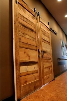 I like how the horizontal boards were used on this reclaimed wood door.  This gives a very unique look. Getting ideas for making new doors from reclaimed wood in our home.