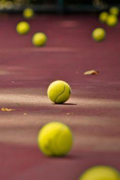 Scattered tennis balls