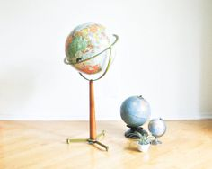 Spark dreams of long-lost times and far-off places with a vintage globe.