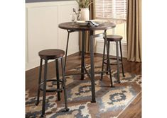 Challiman Round Dining Room Bar Table & 4 Tall Stools by Signature Design by Ashley. Get your Challiman Round Dining Room Bar Table & 4 Tall Stools at Owen's Home Furnishings, Clinton NC furniture store. Round Pub Table, Round Dining Set, Pub Tables, Round Bar, Dining Sets, Small Dining, Bar Table Sets, Patio Bar Set, Small Bar Table