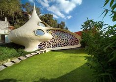 October Nautilus house located near Mexico City is a unique shell shaped house designed by Mexican architect Javier Senosiain of Arquitectura Organica. The house design is very… Unusual Buildings, Beautiful Buildings, Earthship, Organic Architecture, Amazing Architecture, House Architecture, Concept Architecture, Architecture Organique, Shell House