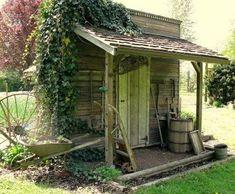 Love it all--barn wood, ivy, wagon wheel, wheelbarrow, wine barrel, rusty tools