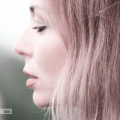 Profile portrait of a young, attractive woman
