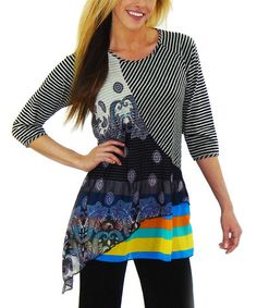 Love the mix of patterns with the bright stripes.