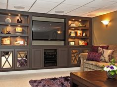 Cozy And Modern Family Room On The Basement With Luxurious Silver Tv Housing And Multi Purpose Racks Jpg
