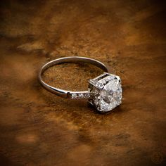 A gorgeous antique cushion cut diamond engagement ring set in a beautiful platinum mounting. Sold by Estate Diamond Jewelry