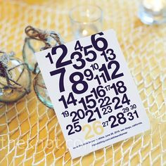 The couple's mod save-the-dates highlighted their wedding date, the 26th, on a rectangular card.