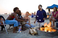 HB firepit: City-maintained firepits add to the festive atmosphere as the sun sets over the Pacific Ocean in Huntington Beach, California