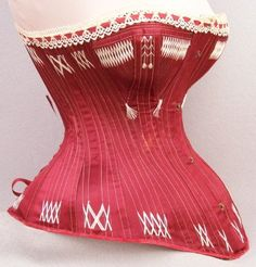 Lot: 401: Rare 1879 Patent Dated Red Silk Satin Corset, Lot Number: 0401, Starting Bid: $600, Auctioneer: Time Travelers Estate Sales, Auction: Fantastic Vintage Clothing & Access. Auction, Date: June 30th, 2012 CEST