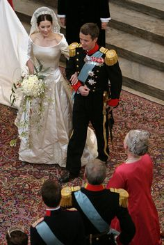 Danish Crown Prince Frederik walks down the isle next to his new bride Princess Mary after they marry in Copenhagen Cathedral May 14, 2004 in Copenhagen, Denmark.