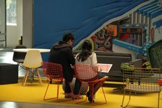 The building has lots of open breakaway spaces where employees can quickly sit down for a chat.