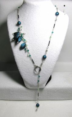tem 1390 - Beautiful Dark Teal Slider Necklace with Polymer Buds, Swarovski Emerald & Peridot Crystals -PROMO OFFER $34 + S&H......(Regularly $36 + $5 S&H.) (SEE MATCHING BRACELET) Designs by LK...Visit all my BEAUTIFUL jewelry pages, just follow the link: https://www.facebook.com/linda.foust.9?sk=photos..