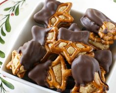 These peanut butter pretzel bites are like a cross between a peanut butter ball and a chocolate covered pretzel. Can sprinkle candies on top too.
