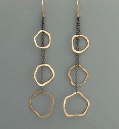 Metal Jewelry Triple lleno de oro de y plata aretes por rachelwilder en Etsy - gold filled hoops dangle from oxidized sterling silver chain. These hoops are formed by hand, soldered, and polished. Measures a little over long from top of the ear wire. Bijoux Design, Schmuck Design, Jewelry Design, Jewelry Accessories, Oxidized Sterling Silver, Sterling Silver Chains, Sterling Silver Earrings, Earrings Handmade, Handmade Jewelry