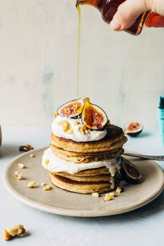 Fluffy grain free pancakes with fresh figs and whipped cream. So fluffy, tender + crisp in all the right places - a grain free pancake dream come true!