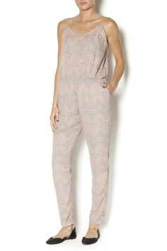 range and grey jumpsuit with adjustable straps and an elastic waist. This jumpsuit is great for casual weekends. Style with sandals and a denim jacket.