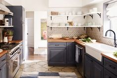 Country kitchen with blue cabinets