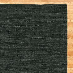 world market, woven leather rug in black, $220