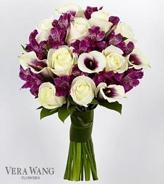 White roses, purple orchids and bi-colored white and purple mini calla lilies. SO pretty!