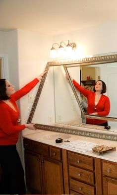Home Stager Kate Hart adds a custom detail to the bathroom with a MirrorMate frame.