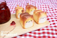 These tiny little loaves of bread are too cute to eat. They're art. Could you really spread jam on that smile?