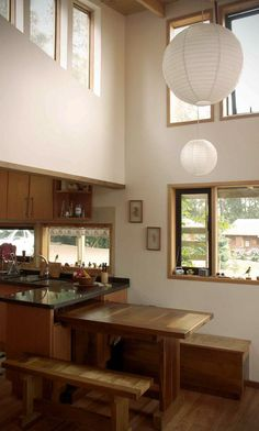 Dining table set-up prompts an idea to create a two-stage fold up/down and pull out table: Casa en los Guindos, a small modern house by Rodrigo del Castillo Small Modern Home, Table Set Up, Small Living, New Kitchen, Kitchen Storage, Space Saving, Home Projects, Dining Table, Dining Room