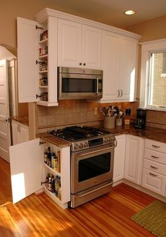 Six-inch deep kitchen cabinets can provide ample storage for many small items. By Neal's Design Remodel.
