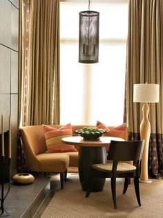Contemporary Living Room Space with Orange Banquette and Circular Table - on HGTV