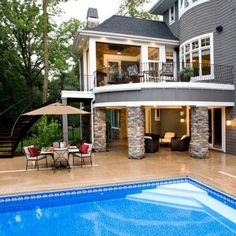 """Beautiful backyard """"deck"""" with steps leading down to pool patio area and covered seating area"""