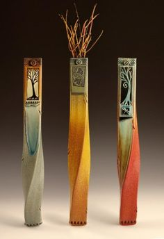 """Michael Macone uses melted glass tiles to adorn his extruded clay sculptures. His Wallies are about 14"""" and 24"""" tall. His warm autumn colors are reminiscent of Fall in his home state of Wisconsin."""