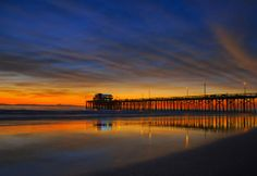 size: Stretched Canvas Print: Newport Beach Pier at Sunset : Entertainment Using advanced technology, we print the image directly onto canvas, stretch it onto support bars, and finish it with hand-painted edges and a protective coating. Augrabies Falls, Newport Beach Pier, Top Pic, Beaches In The World, Painting Edges, Stretched Canvas Prints, Orange County, Surfing, Sunset