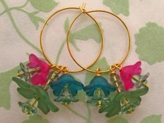 A cluster of budding lucite flowers makes these hoop earrings perfect for spring!